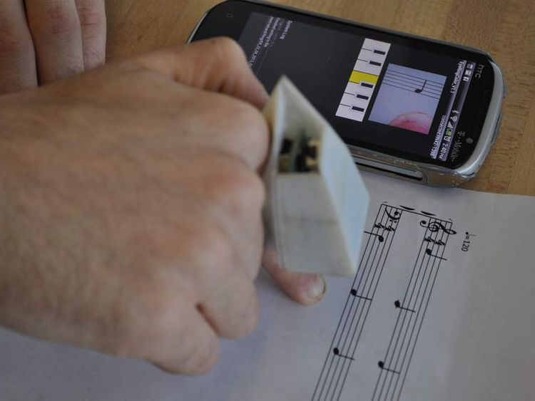 Finger-worn device that reads to the blind