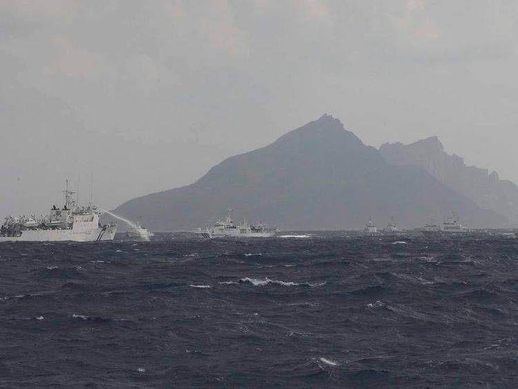 A Taiwanese Coast Guard ship (L) fires water cannons near the disputed East China Sea islands