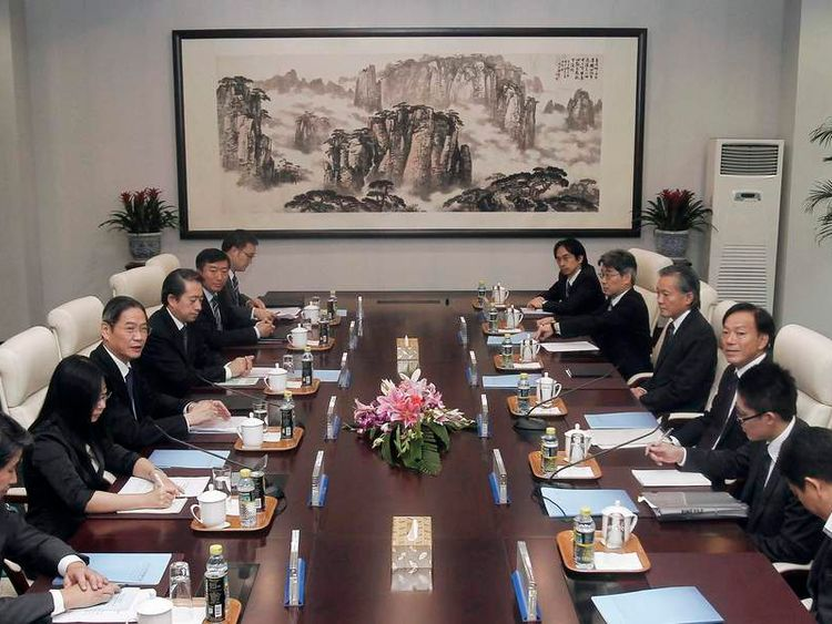 Japan's Deputy FM Chikai Kawai (3rd R) is seen during his meeting to discuss the disputed islands in the East China Sea with Chinese Vice FM Zhang Zhijun (3rd L)in Beijing