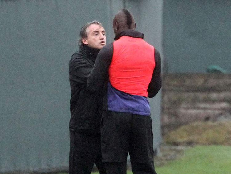 Manchester City manager Roberto Mancini and Mario Balotelli came to blows at the end of training on Thursday morning after a mis-timed tackle by Balotelli.