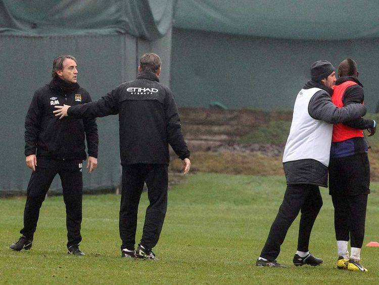 Manchester City manager Roberto Mancini and Mario Balotelli came to blows at the end of training after a mis-timed tackle by Balotelli