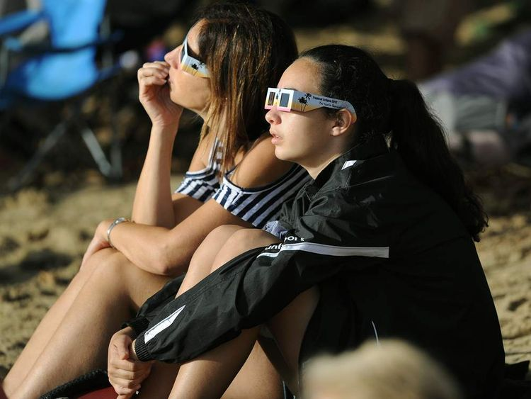 Two women watch total solar eclipse
