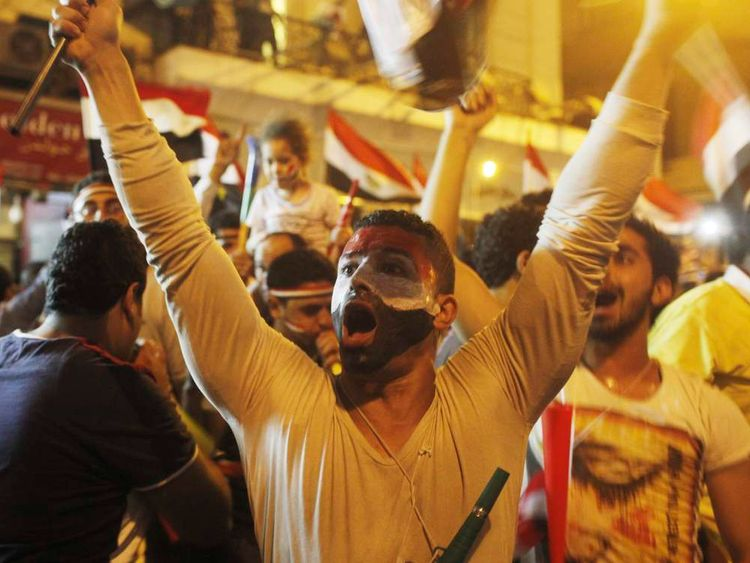 Anti-Mursi protesters chant as they celebrate near Tahrir square after the announcement of the removal from office of Egypt's deposed President Mohamed Mursi