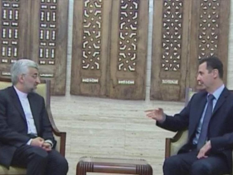 Saeed Jalili and Bashar al Assad