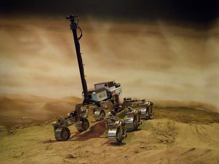 An image of the Exomars rover moving around the sand pit in Stevenage
