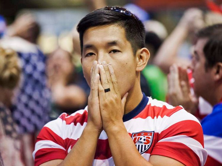 A fan reacts as he watches the U.S. take on Belgium in their World Cup round of 16 match, at a public viewing in Seattle