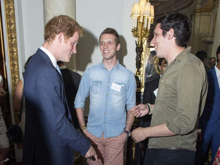 Prince Harry meets tsunami survivors and orphans Paul and Rob Forkan who make and sell 'Gandys' flip flops