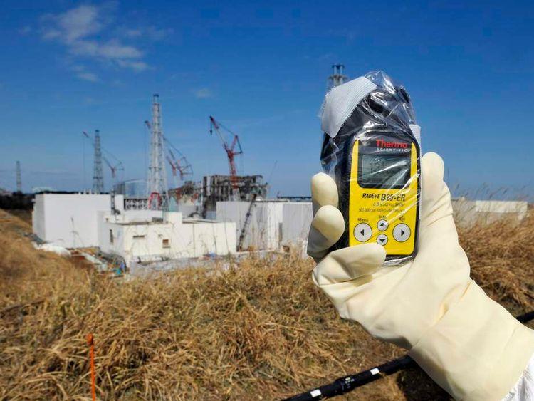 A radiation monitor indicates 131.00 microsieverts per hour at TEPCO's Fukushima Daiichi nuclear power plant in Fukushima