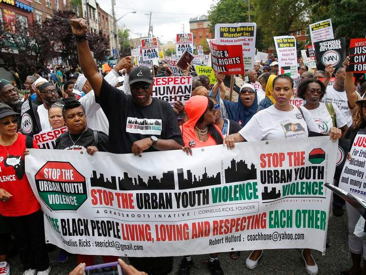 People march for Eric Garner in the Staten Island borough of New York