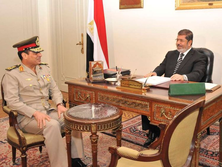General al Sisi at a meeting with Egypt's President Morsi in Cairo last year