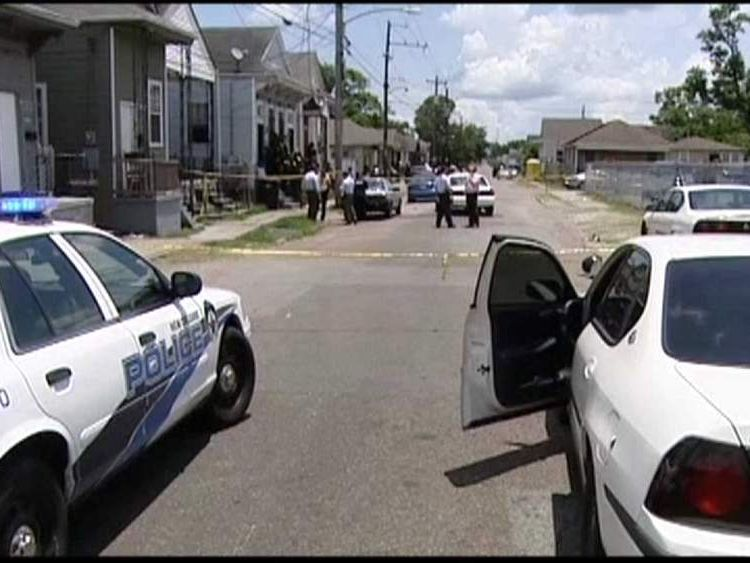Police attend the scene where a five year old shot herself