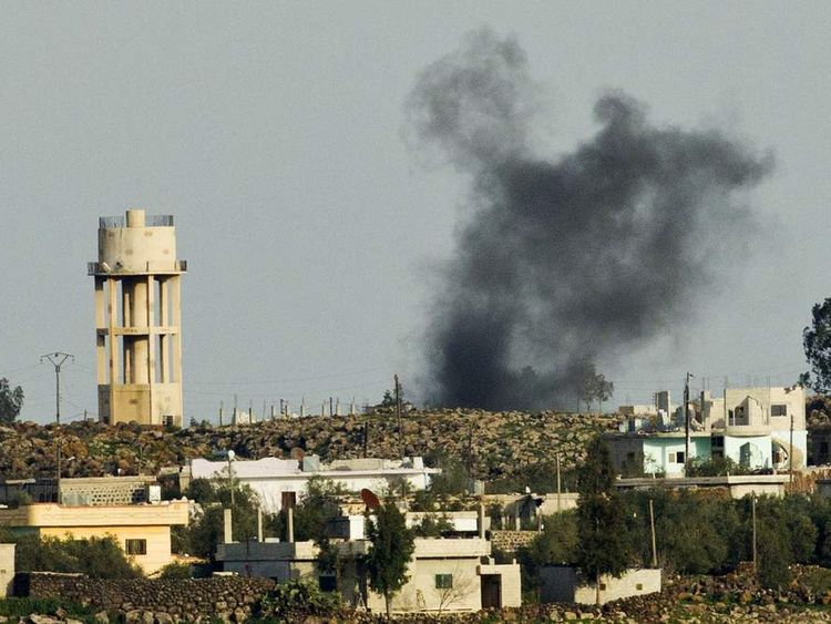 Smoke rising after shells explode in the Syrian village of al Jamlah