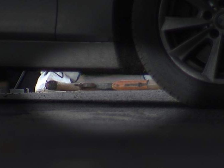 A gun is seen on the ground
