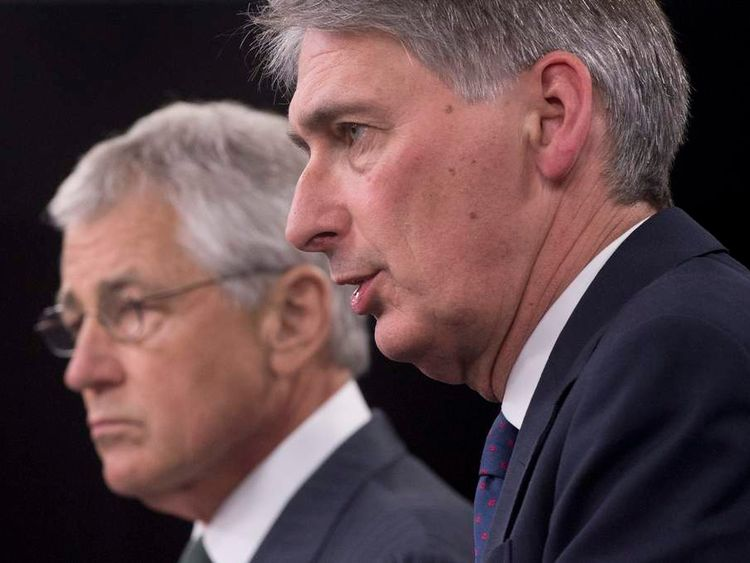 Chuck Hagel (L) and Philip Hammond