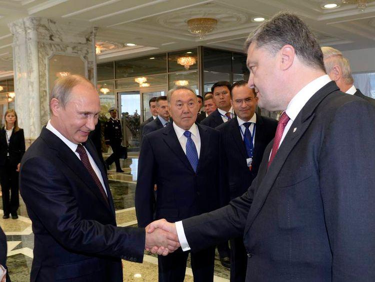 Russian President Vladimir Putin shakes hands with his Ukrainian counterpart Petro Poroshenko in Minsk
