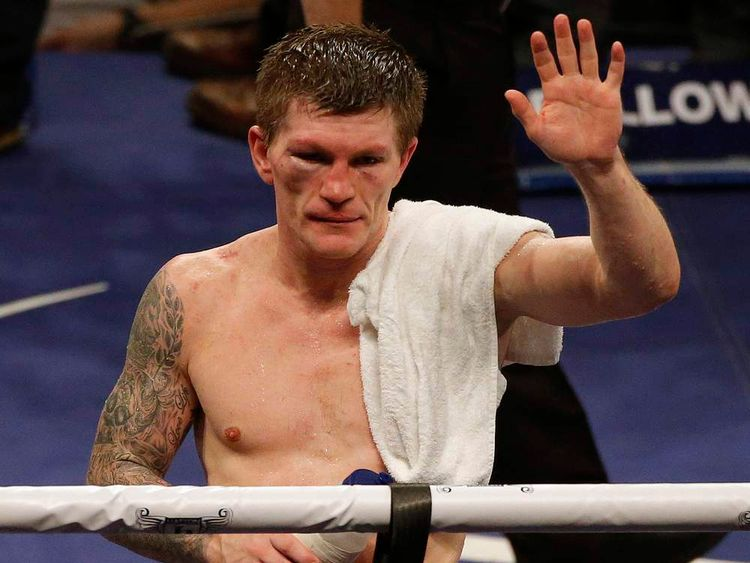 Britain's Hatton reacts after losing to the Ukraine's Senchenko in their boxing match in Manchester