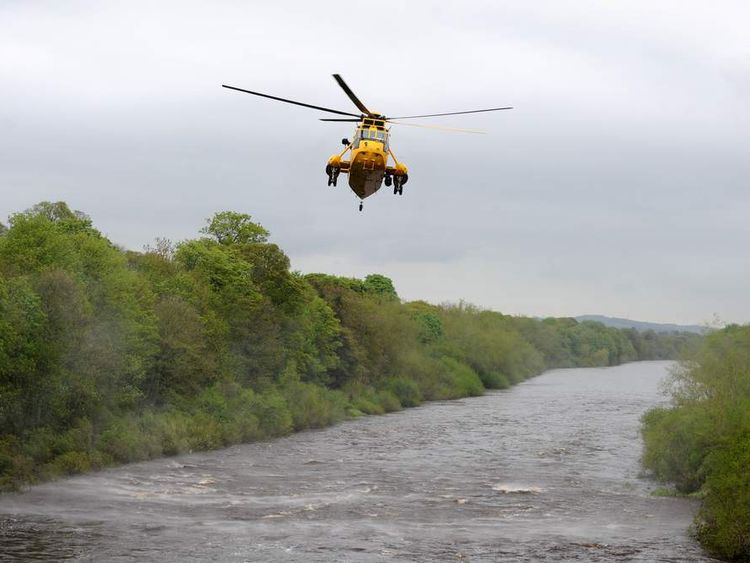 A RAF Sea King Helicopter flies over the River Tyne at Riding Mill