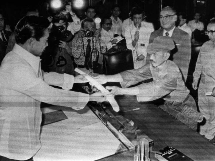 Hiroo Onoda surrenders his sword to Philippine president Ferdinand Marcos