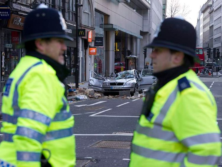 High Holborn is blocked because masonry fell on a car