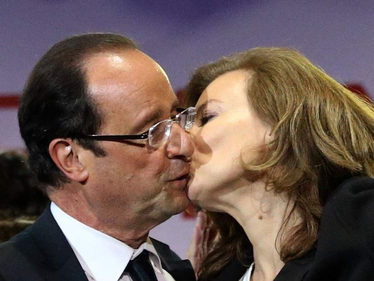 Francois Hollande celebrates with and companion Valerie Trierweiler