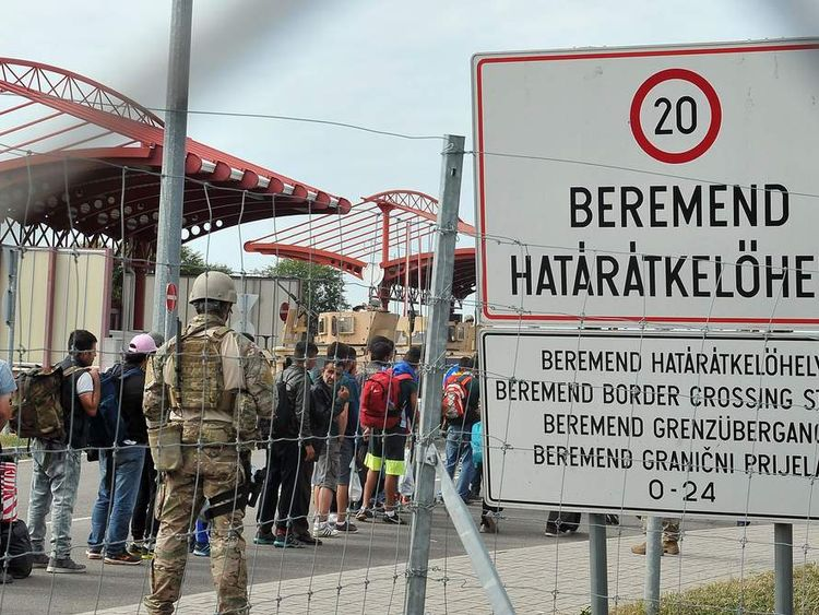 Hungarian guards stand at the border with Croatia