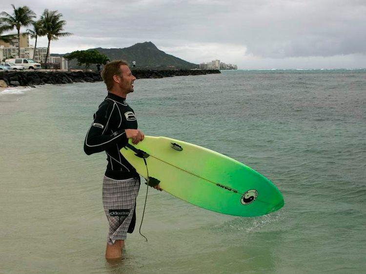 Honolulu surfer as Tropical Storm Iselle passes through the Hawaiian islands