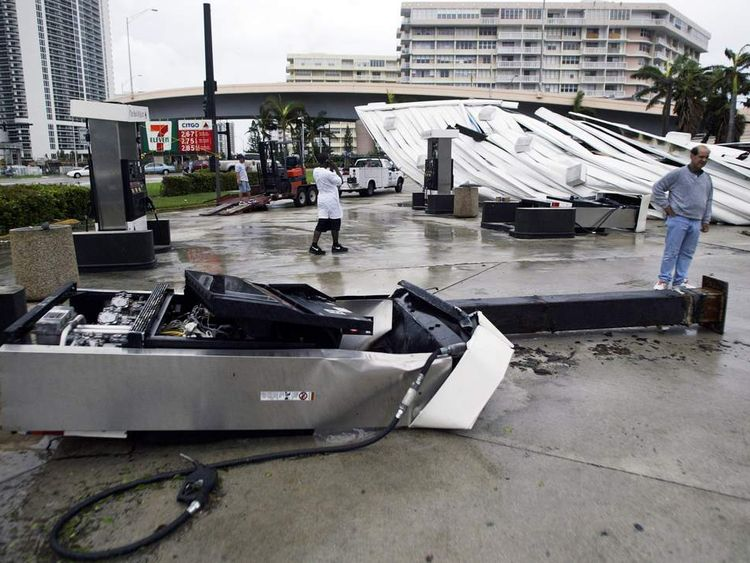 People see the damage done to a petrol station during Hurricane Katrina in 2005