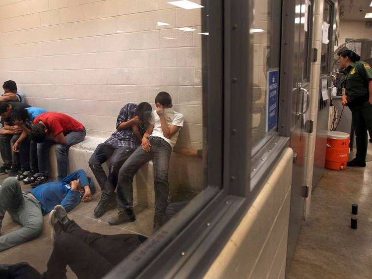 Immigrants at a Border Patrol Station in McAllen, Texas, on July 15, 2014