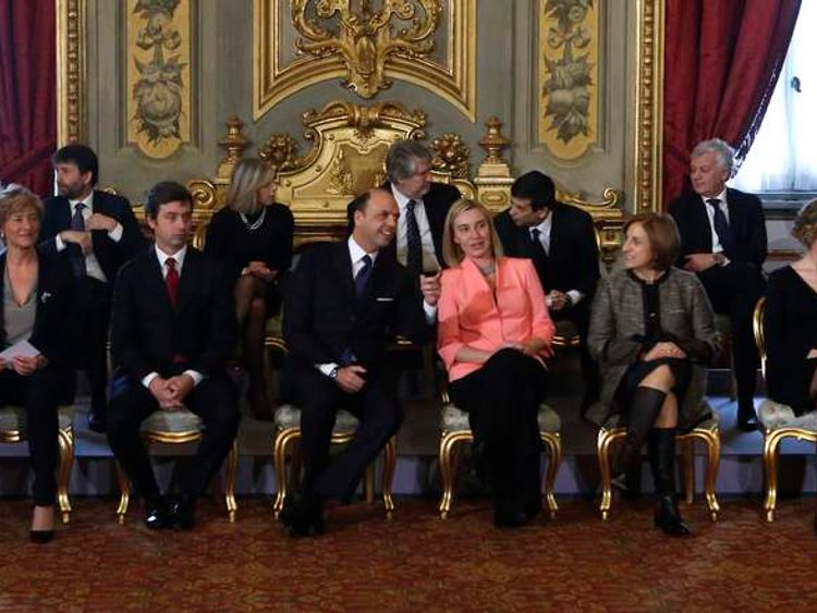 New ministers talk as they sit before the swearing in ceremony at Quirinale palace in Rome