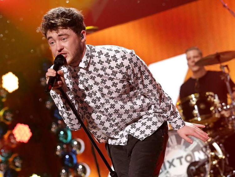 Jake Roche appearing on stage last year