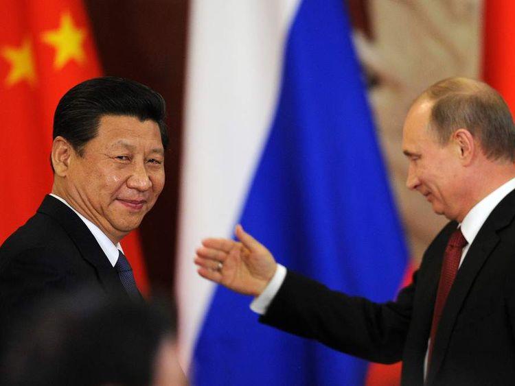 Xi Jinping (L) and Vladimir Putin