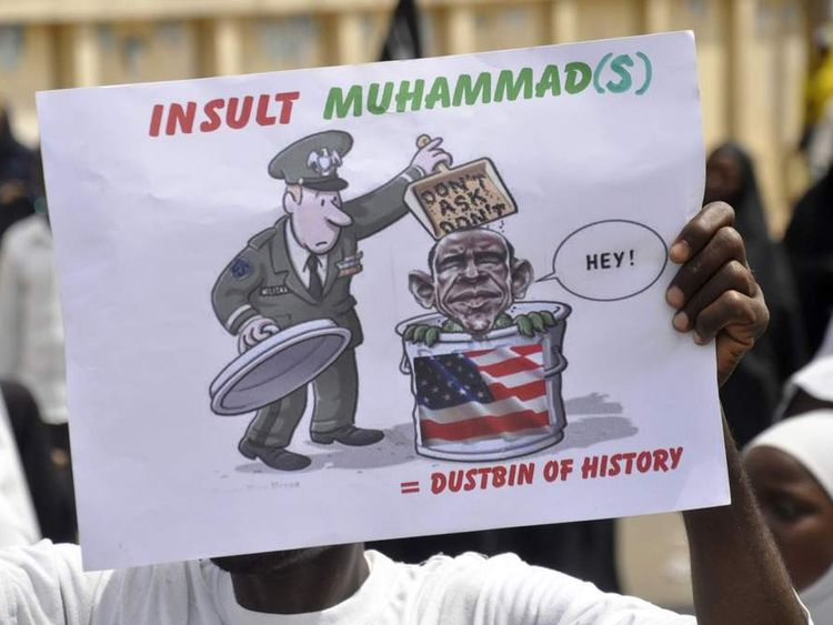 A Muslim demonstrator holds a placard during a protest to denounce an anti-Islam film