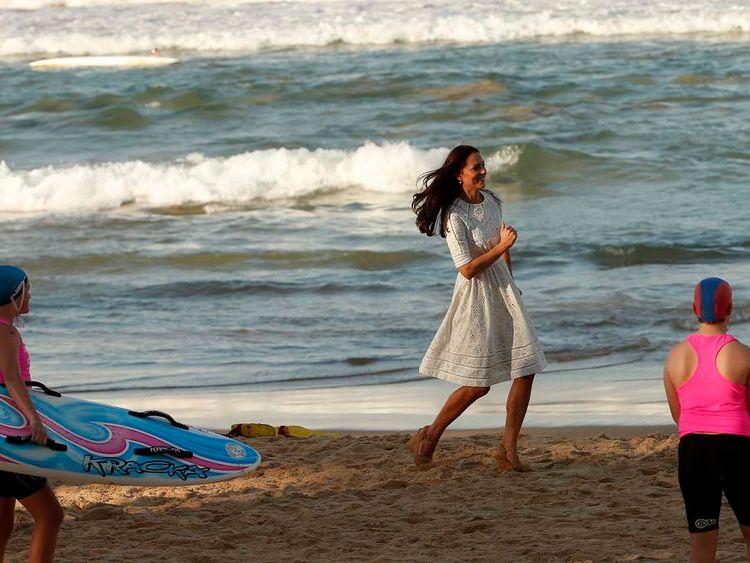 Kate runs across Manly beach in Sydney