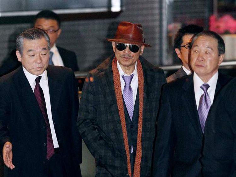 Kenichi Shinoda (C), the boss of Japan's