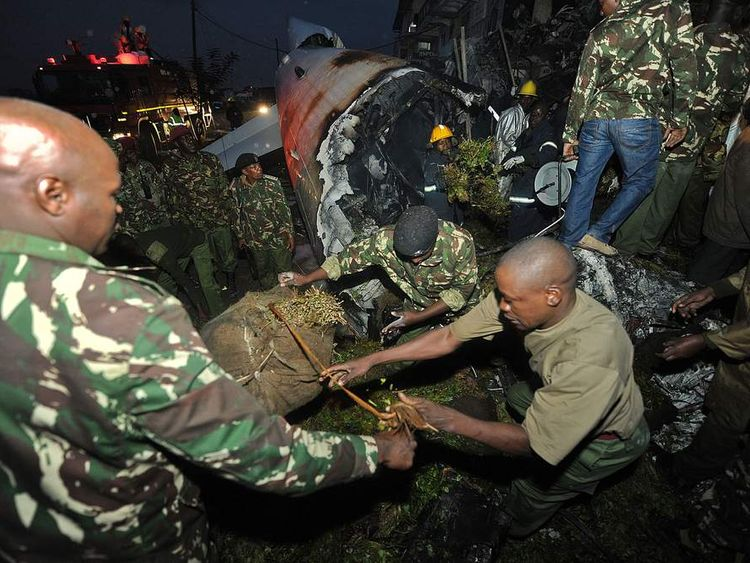 Police and firefighters at the scene of Nairobi plane crash