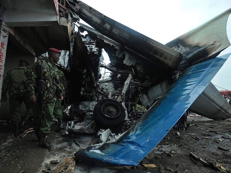 Kenyan soldiers stand near wreckage of plane which crashed in Nairobi