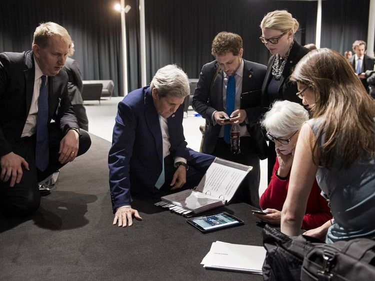 U.S. Secretary of State Kerry and U.S. Under Secretary for Political Affairs Sherman watch a tablet in Lausanne following Iranian nuclear talks