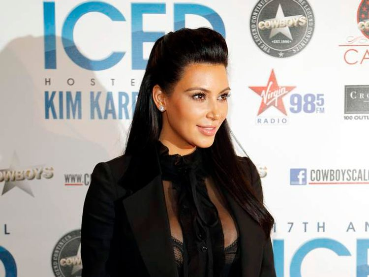 Reality TV star Kim Kardashian poses on the red carpet before the start of the Cowboys' Iced event in Calgary