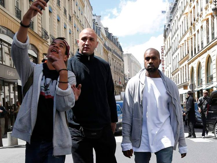 Rapper Kanye West  arrives at a fashion designer shop in Paris