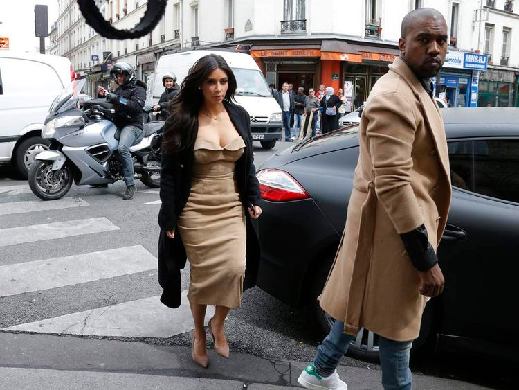 TV personality Kim Kardashian and rapper Kanye West arrive at a fashion designer workshop in Paris