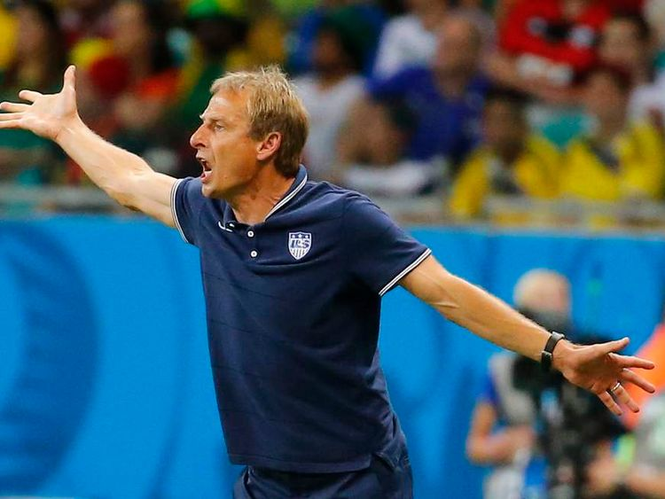 U.S. coach Klinsmann gestures during extra time in their 2014 World Cup round of 16 game against Belgium in Salvador