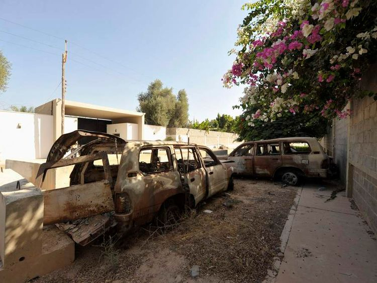 The remnants of cars from attack on US Consulate, which killed US Ambassador Stevens, are seen near wall of consulate in Benghazi in 2012