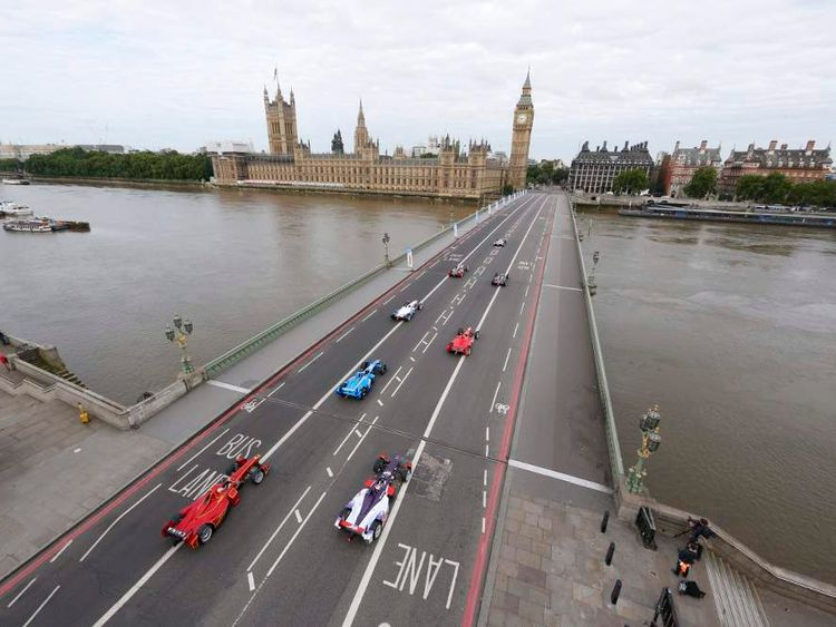 Formula E cars line up to start a trial on Westminster Bridge