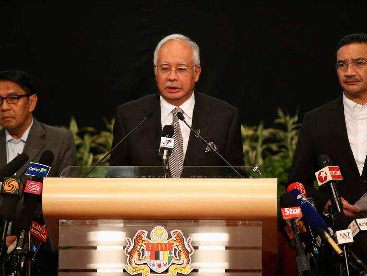 Najib Razak makes an announcement on the latest development on the missing Malaysia Airlines MH370 plane at Putra World Trade Center in Kuala Lumpur