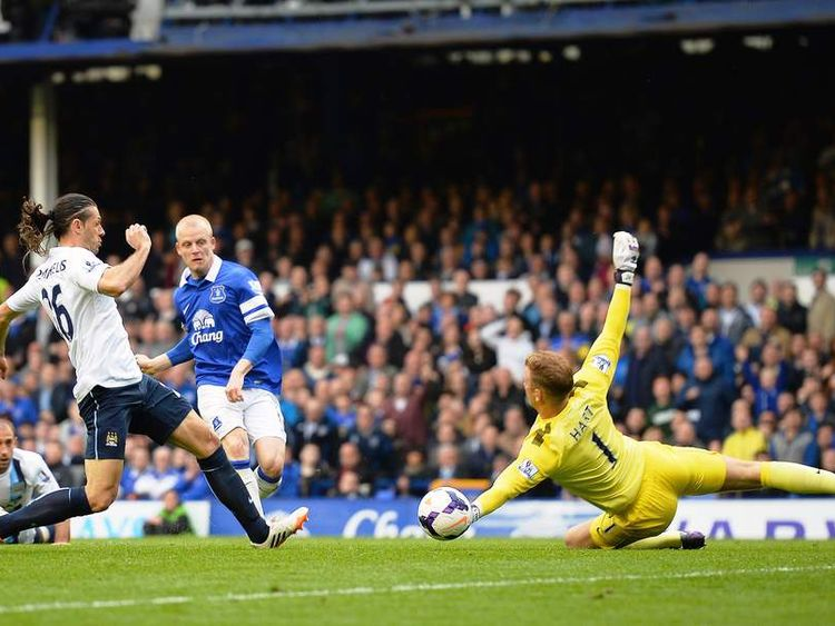 Joe Hart of Manchester City saves a goal of Steven Naismith of Everton