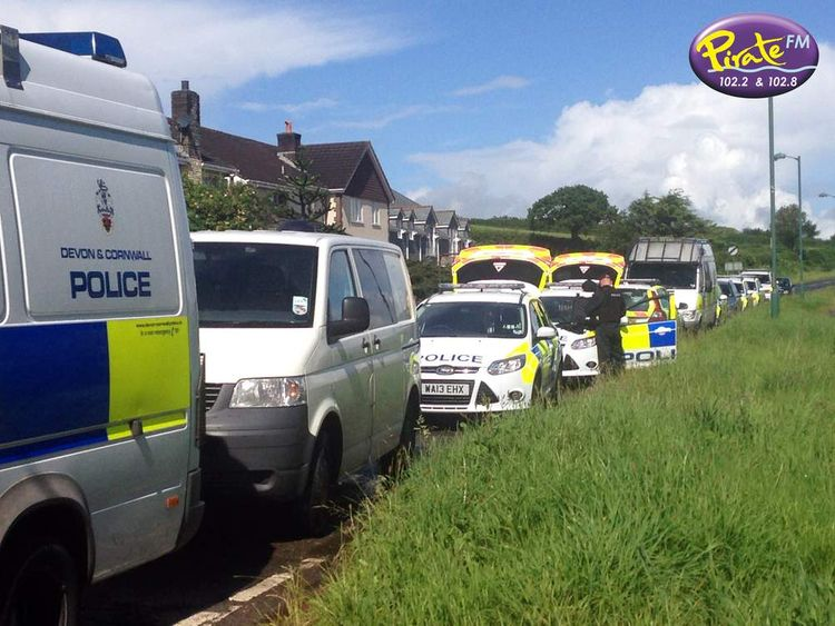 "Police are maintaining a ""high presence"" at the scene near Looe."