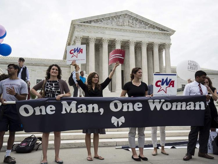 Supporters of traditional marriage between a man and a woman rally in front of the Supreme Court