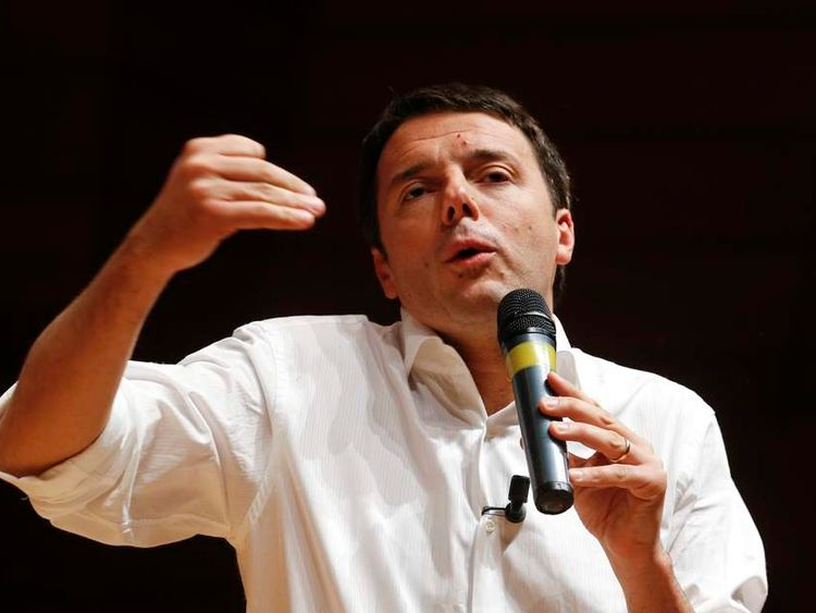 Democratic Party member and Mayor of Florence Matteo Renzi gestures as he rallies onstage in Milan