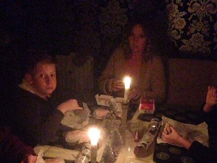 Rolt family sitting down to a candlelit McDonald's meal on Christmas Eve