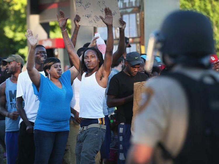 Demonstrators protest the killing of Michael Brown in Ferguson, Missouri